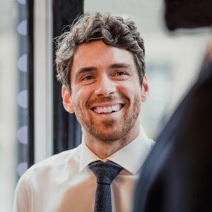 Individual smiling business man