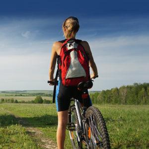 Individuals lady on bike