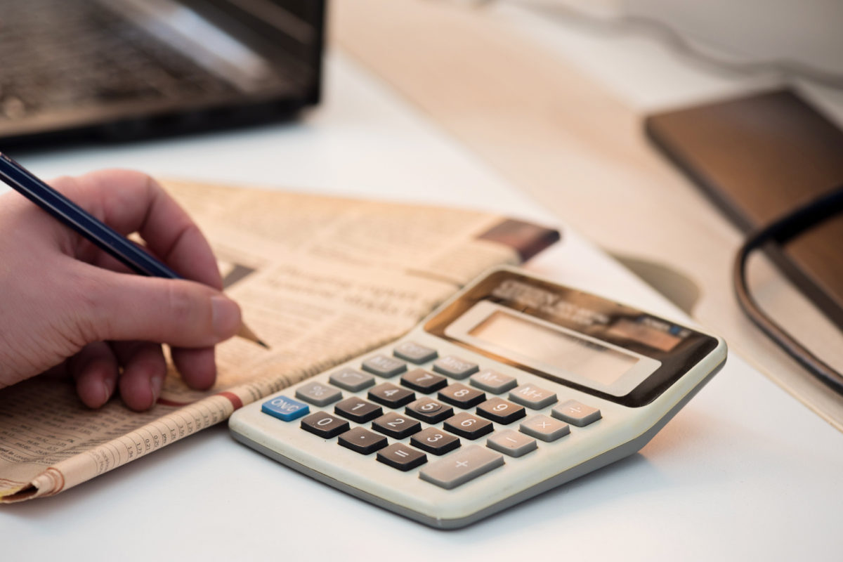 Image of a person using a calculator
