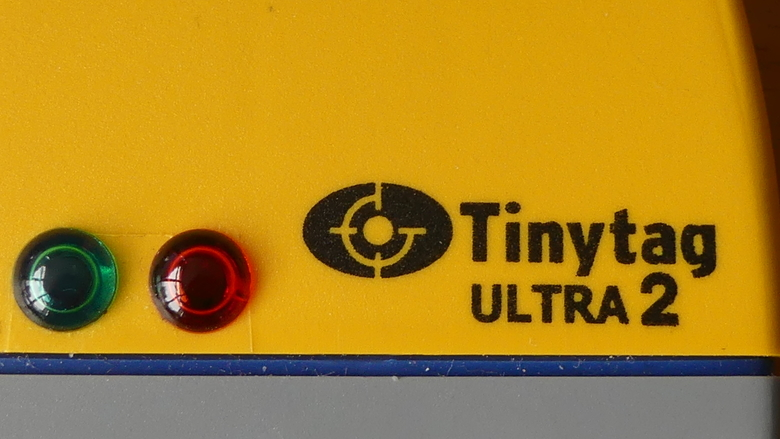 A close-up of the green and red LEDs on a Tinytag Ultra 2 data logger.