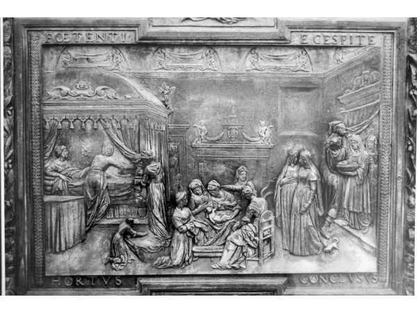 Close up of bronze door panel from Pisa Cathedral - Birth of the virgin by Giambologna
