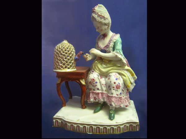 Lady with a parrot, 19th centrary ceramic