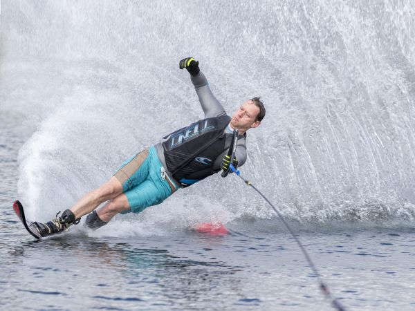 Slalom water skier in deep concentration