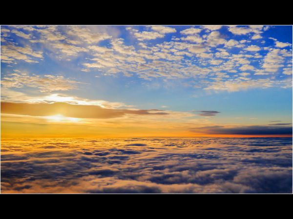 Sun rising above the clouds