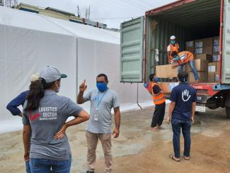 Unloading of the gowns at the Cox's Bazar COVID-19 Special Hub. Photo: WFP/Brook DuBois