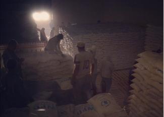 Loading of humanitarian aid at 4 a.m. in Erbil, Northern Iraq, 2014. Photo: Magnus Bruun Rasmussen