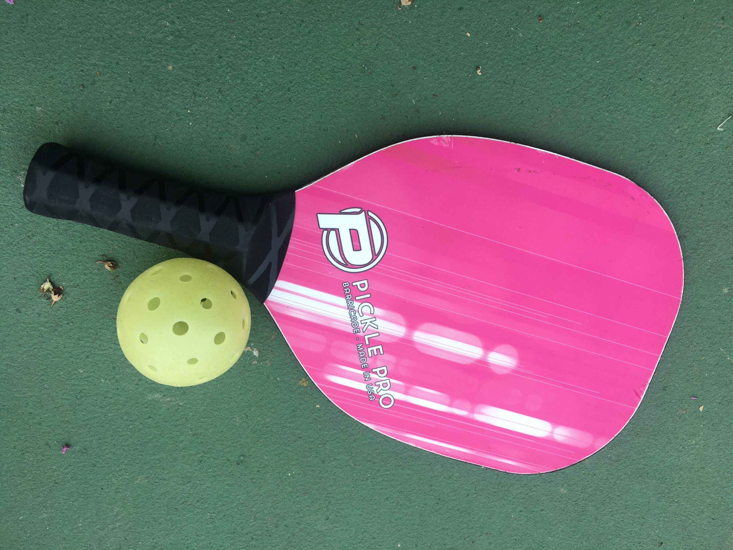 pickleball racket laying the ground