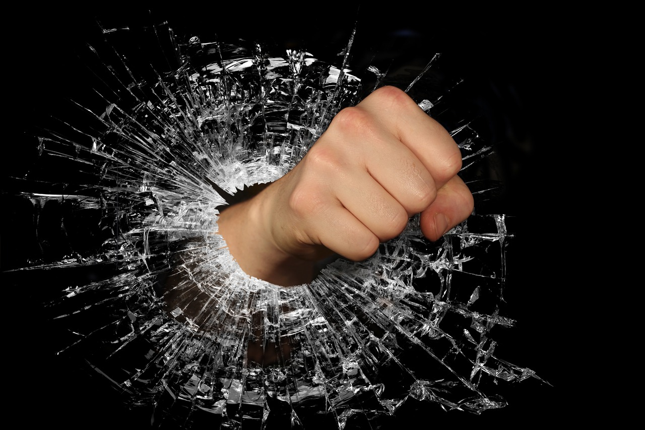 Fist smashes throught the glass