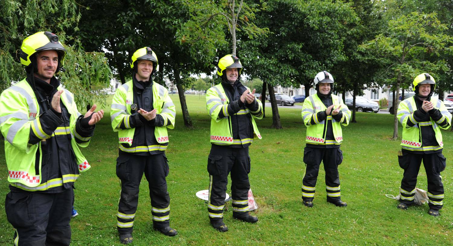 Firefighters from Ballincollig applauding as Oliver completed his 5,000m fundraising walk.