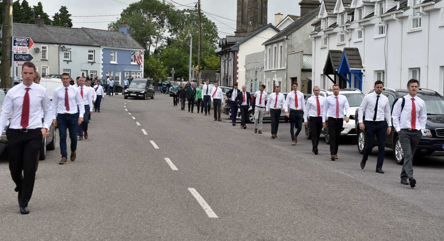 Cork players lead the funeral cortege through Aghada.