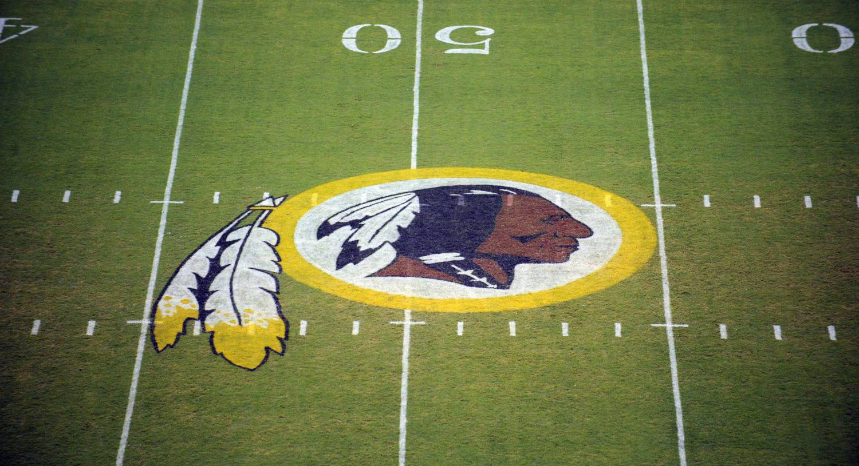 The Washington Redskins logo on the field. AP Photo/Nick Wass, File