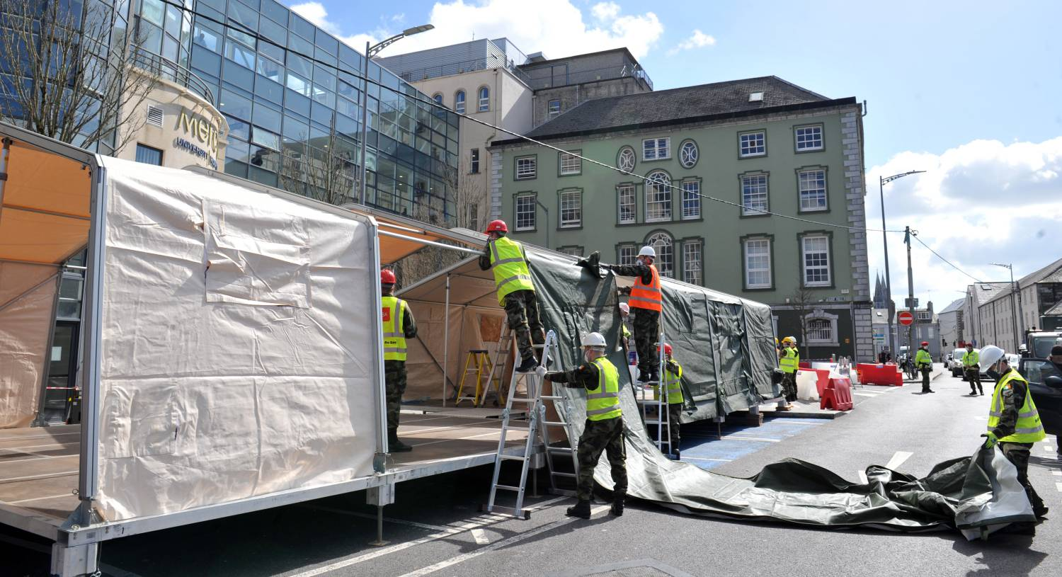 Army on standby to assist HSE as soldiers erect tents at the Mercy Hospital in Cork