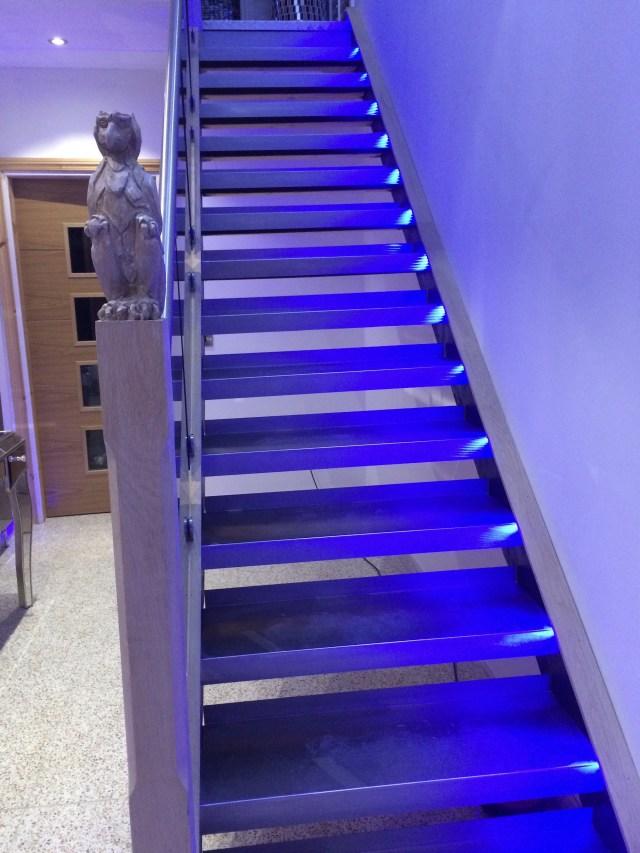 Bespoke stainless steel, white tint oak & tint glass staircase