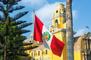 Peruvian flag and church, Lima