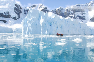 Zodiac cruising past icebergs in Antarctica