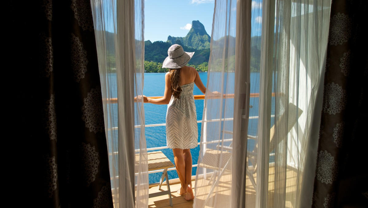 Balcony suite on Paul Gauguin Cruises - Read our cabin size guide to find out more