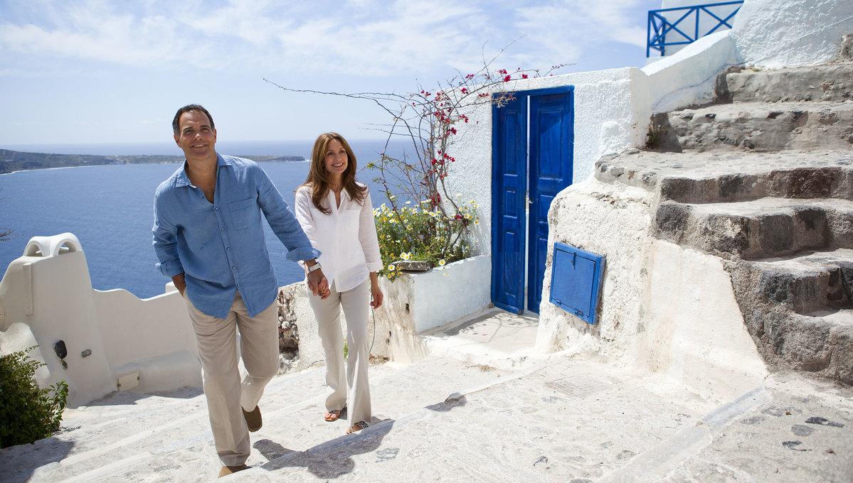 Couple on a shore excursion in Santorini, Greece
