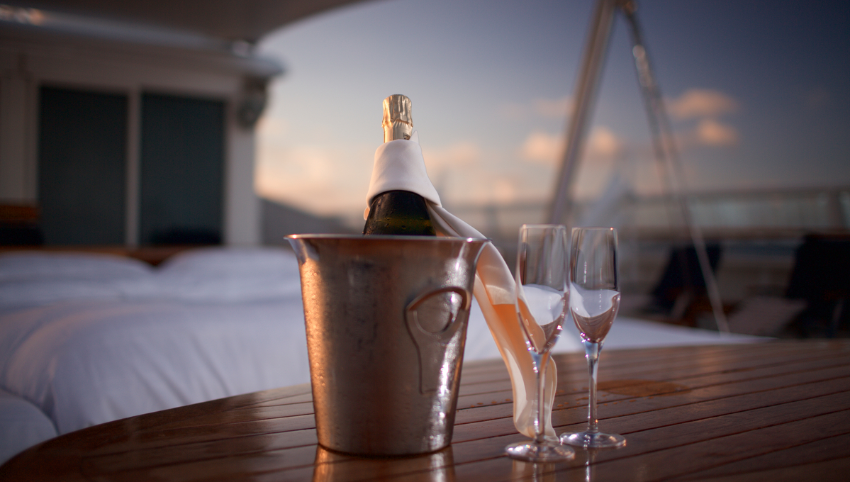 Champagne and Balinese bed on SeaDream Yacht Club