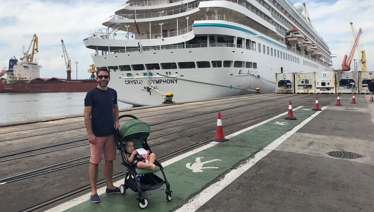 Crystal Cruises family review - Alex next to Crystal Symphony