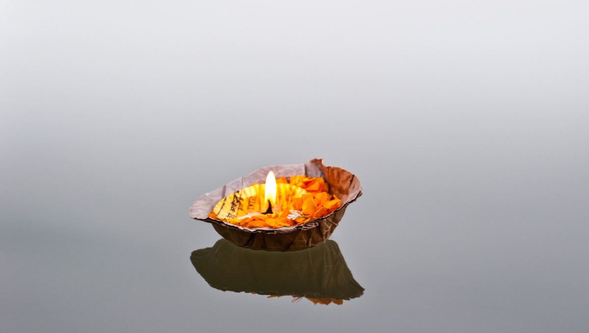 Ganges & Brahmaputra river cruises - Floating pooja candle in Varanasi