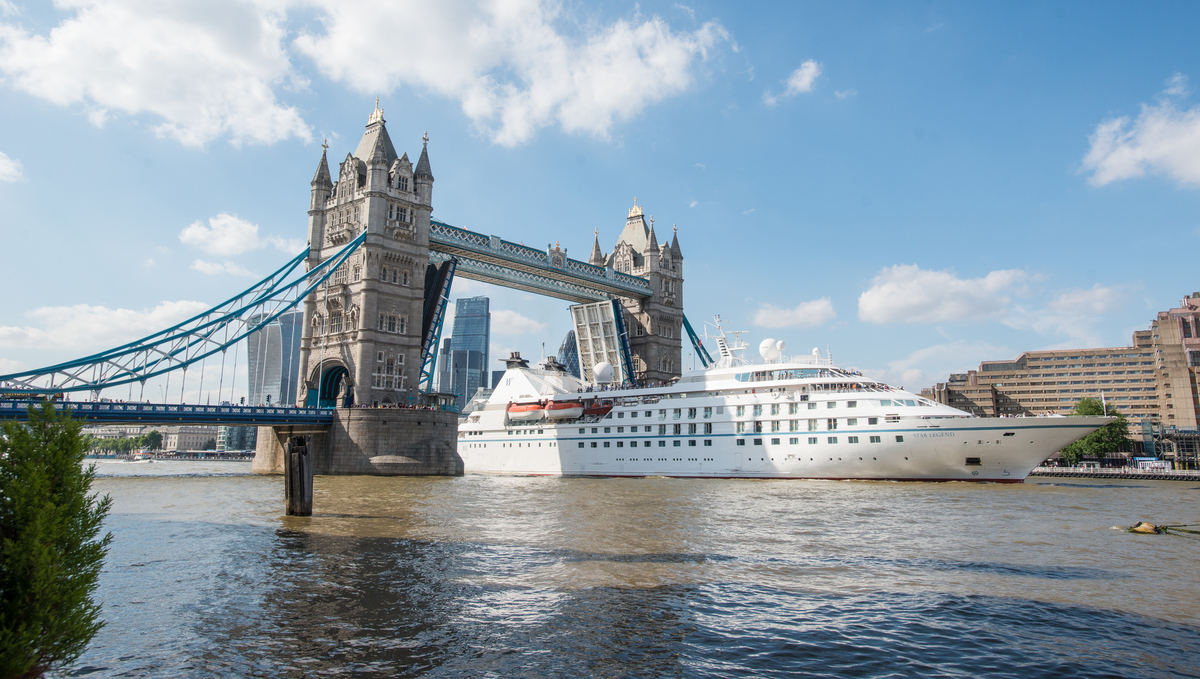 Windstar's Star Legend cruises the Thames river, passing under Tower Bridge