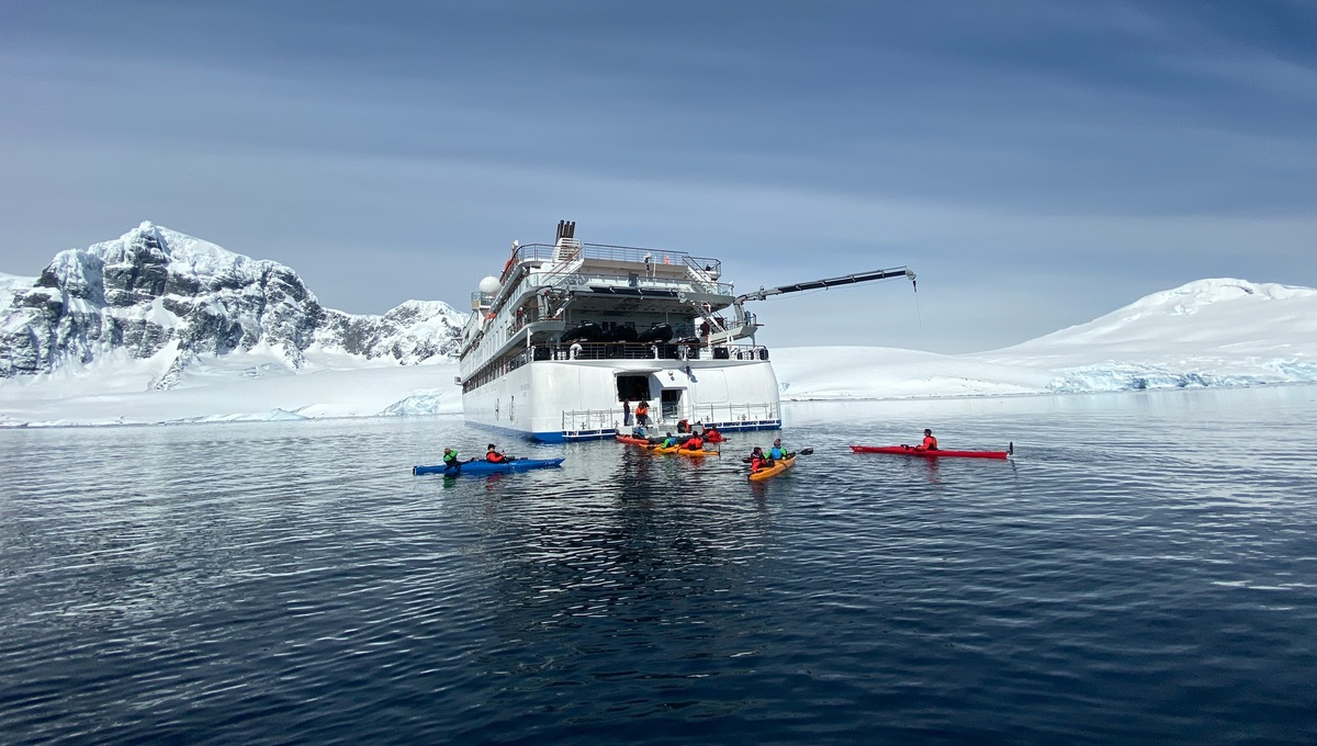 Aurora Expeditions - Greg Mortimer with kayaks in Antarctica