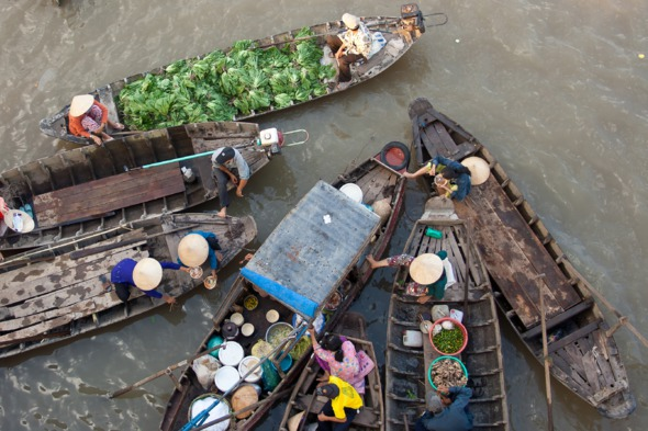 Floating market on the Mekong river in Vietnam