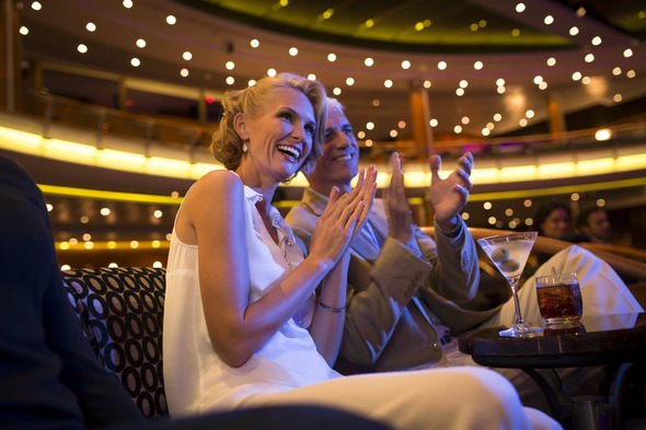 Guests in the theatre on Regent Seven Seas Voyager