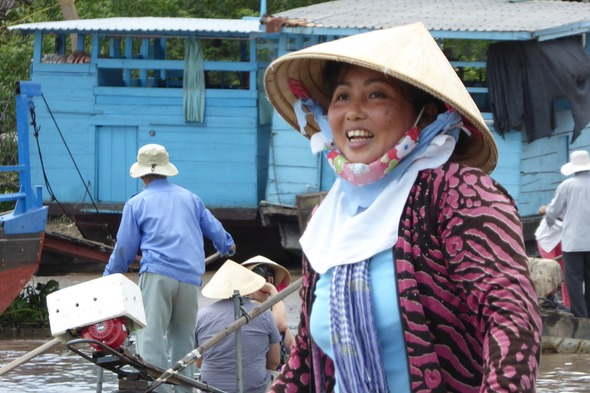 Happy lady on the Mekong in Cai Be, Vietnam