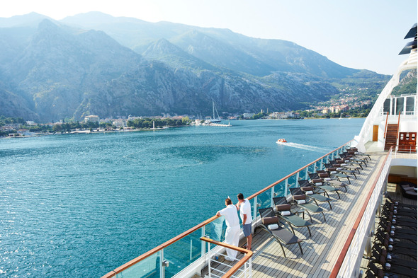 Couple on a Seabourn cruise through the fjords