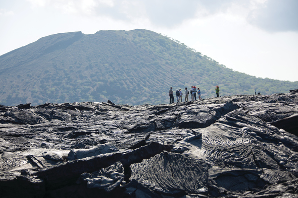 Silver Galapagos - Guests walking on lava rock