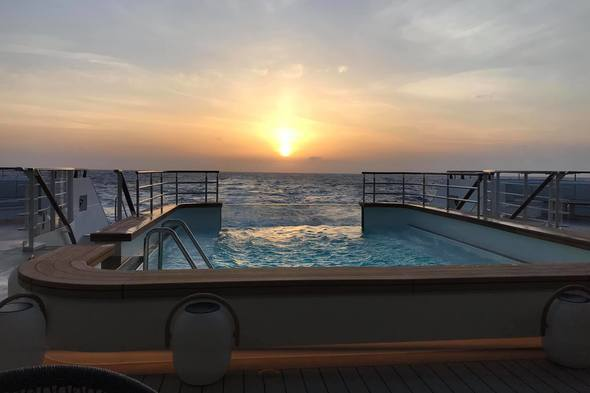 Ponant - Le Bougainville, sunset over the pool deck