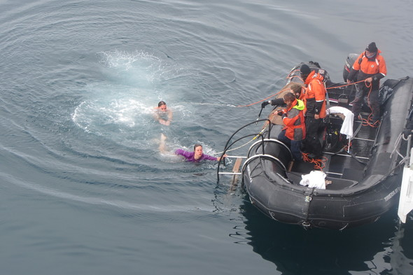 Alex taking the polar plunge in Antarctica