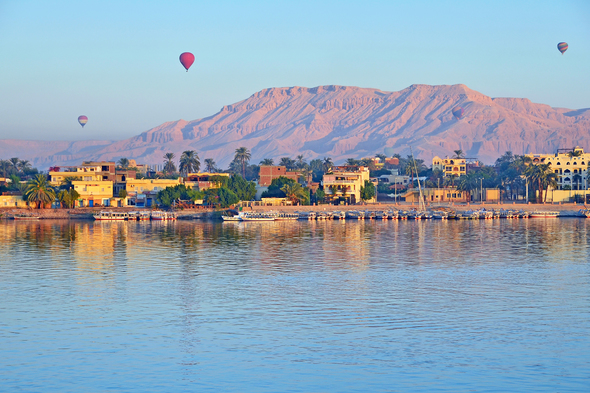 Hot air balloons over the river Nile in Luxor, Egypt