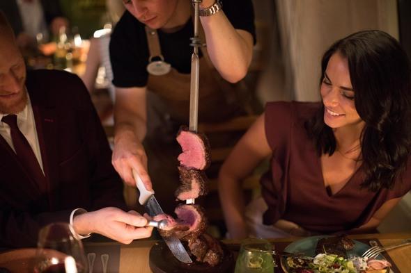 Couple dining in Churrascaria restaurant on Crystal Symphony