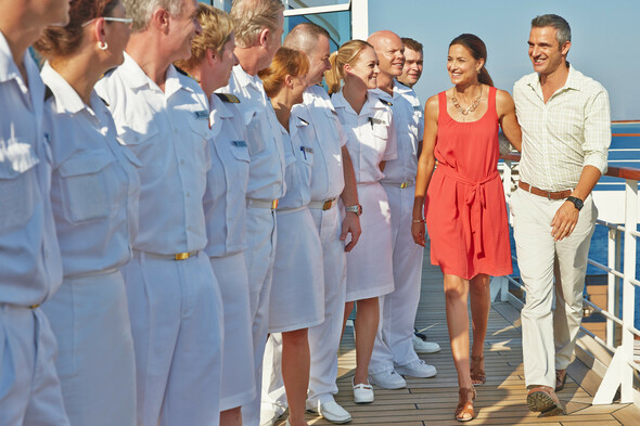 Seabourn guests being welcomed on board