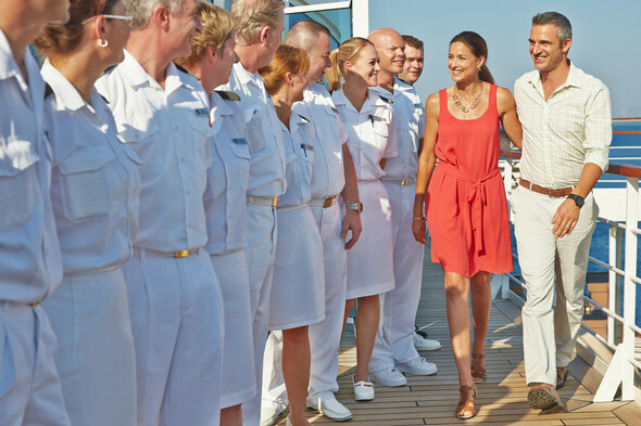 Seabourn crew welcoming guests on board