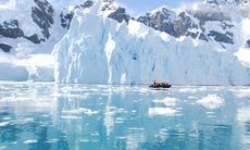 Zodiac cruising past icebergs in Antarctica