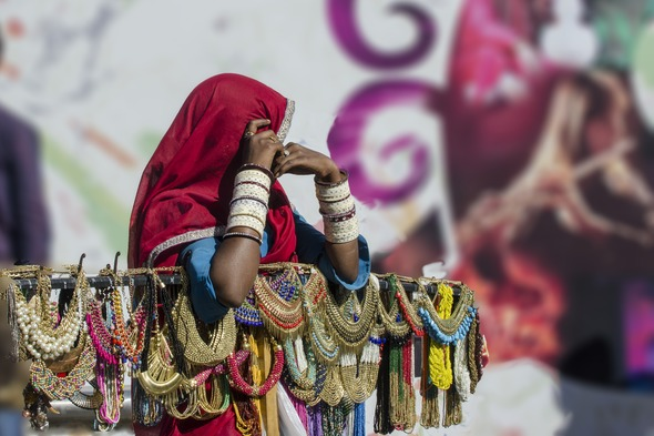 Woman selling necklaces in Mumbai, India