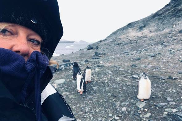 Sharon and penguins in Antarctica