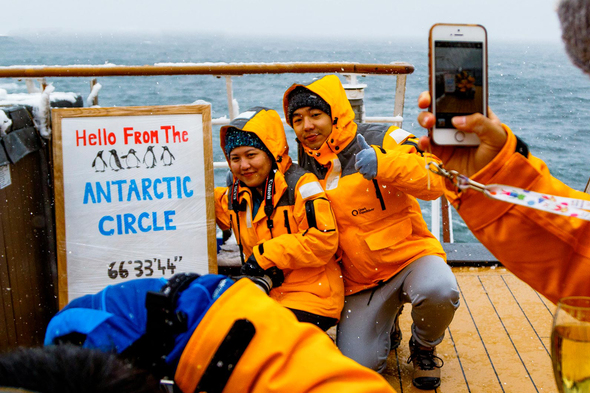 Quark Expeditions - iPhone photo of couple crossing Antarctic Circle