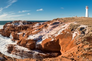 Borgot lighthouse on the red cliffs of the Magdalen Islands, Canada