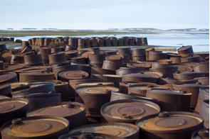 Rusty barrels on Graham Bell Island, Franz Josef Land, Russia