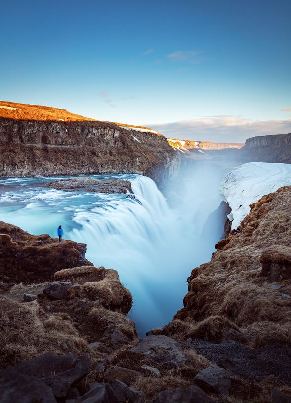 Iceland cruises - Traveller by waterfall