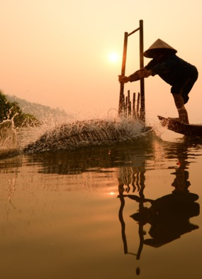 A fisherman on the Mekong, one of our favourite river cruise destinations