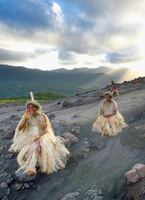 Islanders on Mount Yasur in Tanna, Vanuatu, one of the most amazing Pacific islands you can visit on an expedition cruise