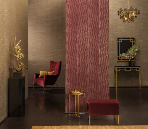 Turn of century interior with red velvet and golden furniture. Gold metallic foil wallcoverings on the walls.