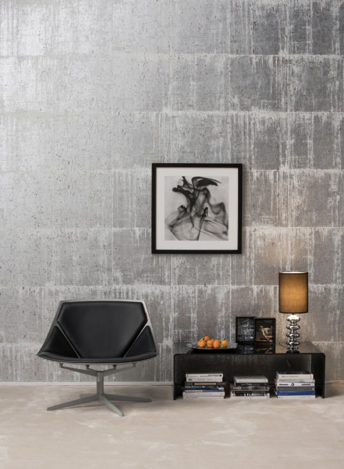 Antarès silver and white blocks wallcovering, black chair, painting with smoke.