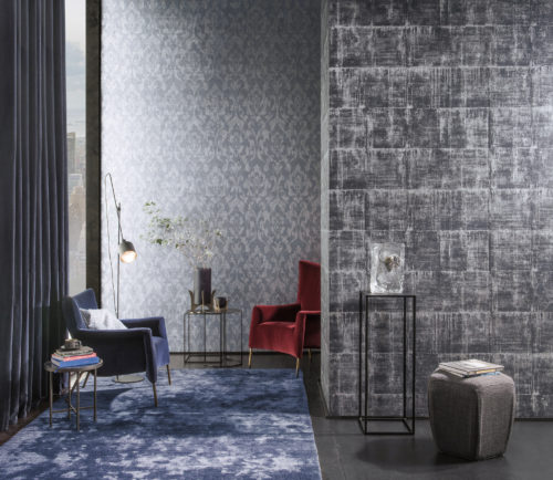 Room with large window and velvet curtain in the city. Red and blue velvet armchairs. Silver and white Antarès wallcovering on both walls.