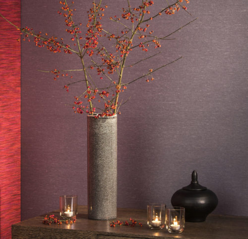 Warm setting with a grey vase with berries, candles, purple and bright red Elegance wallcovering.